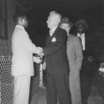 Freddie greeting New York Senator Kenneth B. Keating arriving at the Thomases' home on Skuse Street in 1957.